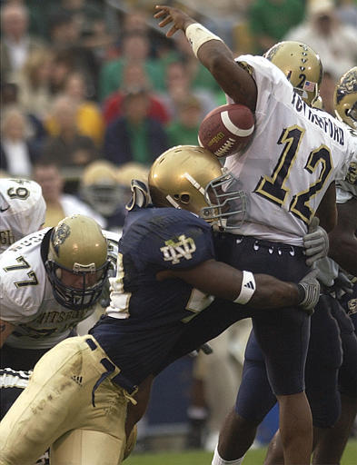 Justin Tuck (shown here causing a fumble vs. Pittsburgh in 2002) is poised to become one of the most dominant defensive players in college football this season.