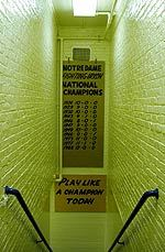 The Notre Dame football team travels down the steps and under the Play Like A Champion sign before moving into the tunnel and on to the field at Notre Dame Stadium.