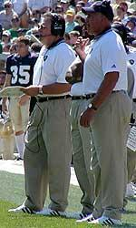Notre Dame assistant coaches Kent Baer and Greg Mattison on the sideline of a game during the 2002 season (File Photo)
