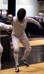 Aaron Adjemian - shown competing in Thursday's opening NCAA bouts - and fellow sophomore epeeist Amy Orlando have logged plenty of air miles while pursuing their love of fencing (photo by Pete LaFleur).