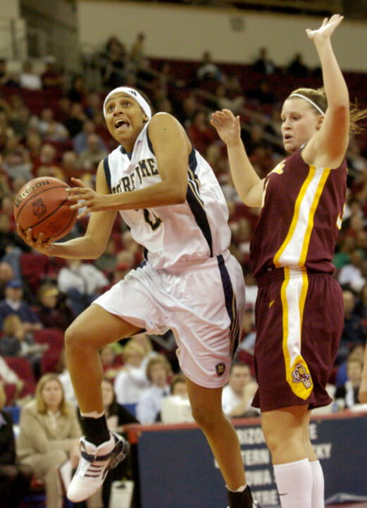 Jacqueline Batteast drives to the basket in front of Arizona State forward Amy Denson.