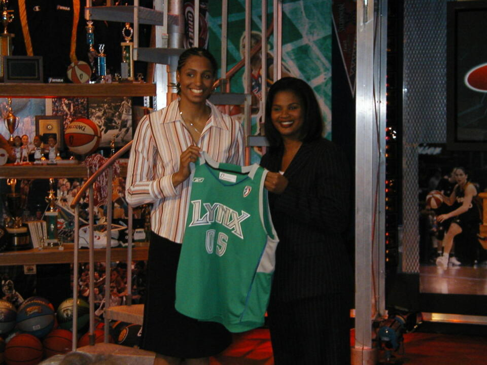 Notre Dame All-America forward Jacqueline Batteast shows off the colors of her new team, the Minnesota Lynx, after she was picked with the 17th overall selection in the 2005 WNBA Draft. (photo by Chris Masters)