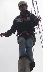 Ellen Heintzman atop the 30-foot pole on the ropes course on Pohorje Mountain.
