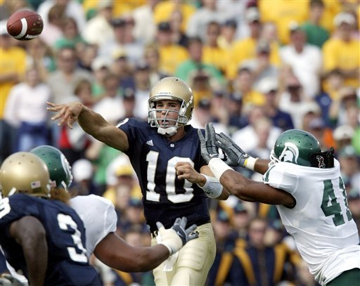 Brady Quinn throws for a school-record five touchdowns and a career-high 487 yards.