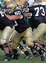 Dan Santucci (50) along with teammates Ryan Harris (68) and Mark LeVoir (73) perform as precision unit to hold off the Michigan State pass rush in the September 11 game at Notre Dame Stadium.