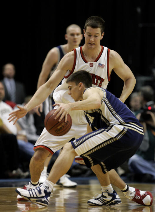 Notre Dame's Chris Quinn, front, is defended by North Carolina State's Andrew Brackman during the first half. (AP Photo/Darron Cummings)