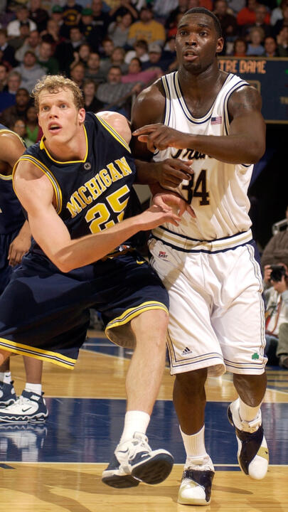 Torin Francis battles with Michigan forward Graham Brown for position in the second half.