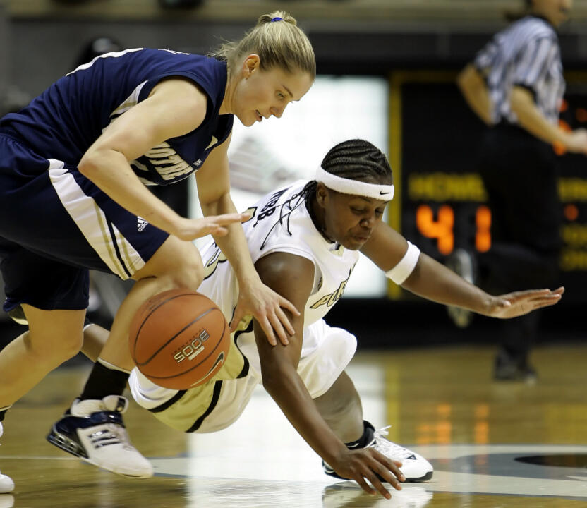 Purdue's Sharika Webb, right, and Megan Duffy scramble for a loose ball during the second half. (AP Photo/Michael Conroy)