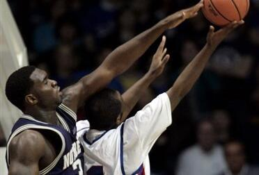 Torin Francis goes for a rebound with DePaul's Jabari Currie in the first half.
