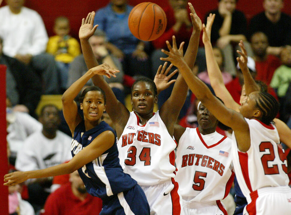 Charel Allen gets pressure from Rutgers' Michelle Campbell (34), Essence Carson (5) and Cappie Pondexter (25) during the first half. (AP Photo/Tim Larsen)