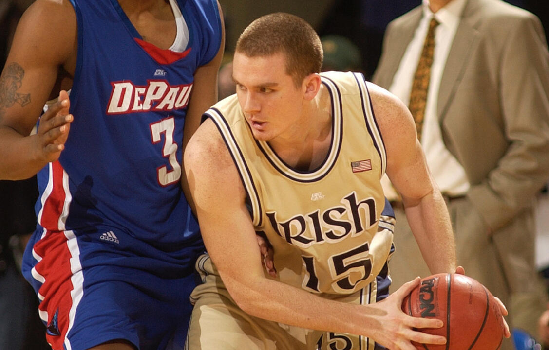 Notre Dame guard Colin Falls (15) gets ready to throw a pass as DePaul guard Draelon Burns (3) defends during the first half of a college basketball game Saturday, March 4, 2006, in South Bend, Ind. (AP Photo/Joe Raymond)