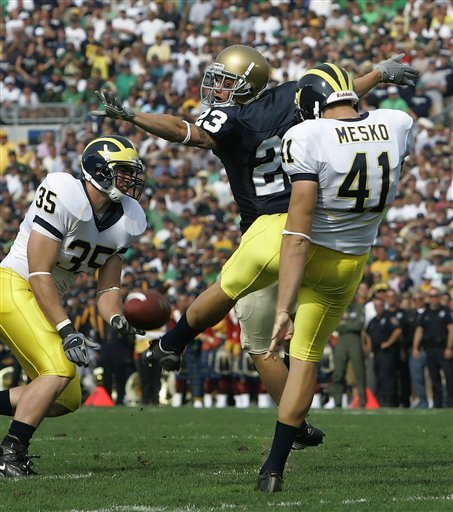 Notre Dame defensive back William David Williams, center, nearly blocks the punt of Michigan punter Zoltan Mesko (41) during the first quarter.  (AP Photo/Michael Conroy)