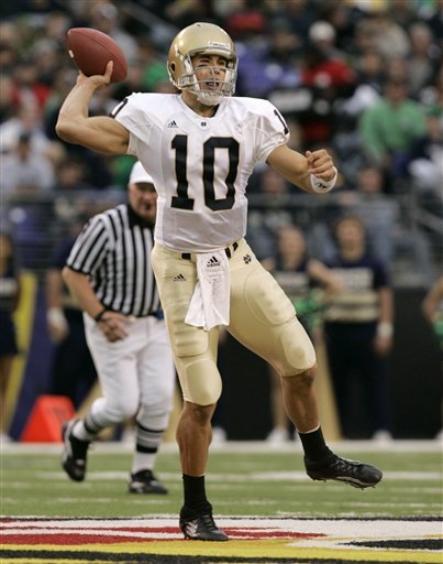 Brady Quinn throws a pass during the first half of the game vs. Navy in Baltimore