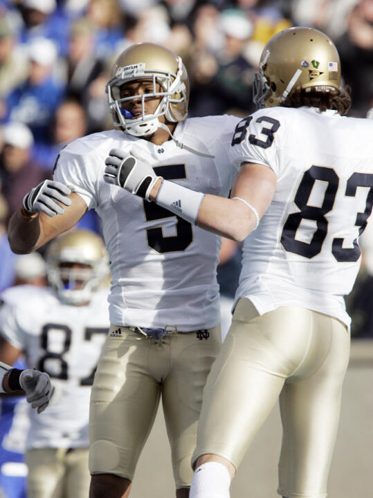 Rhema McKnight celebrates a touchdown against Air Force with teammate Jeff Samardzija.