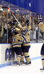 The Irish celebrate Kevin Deeth's third-period goal with 2:17 left that gave Notre Dame a 2-2 tie with Miami.
