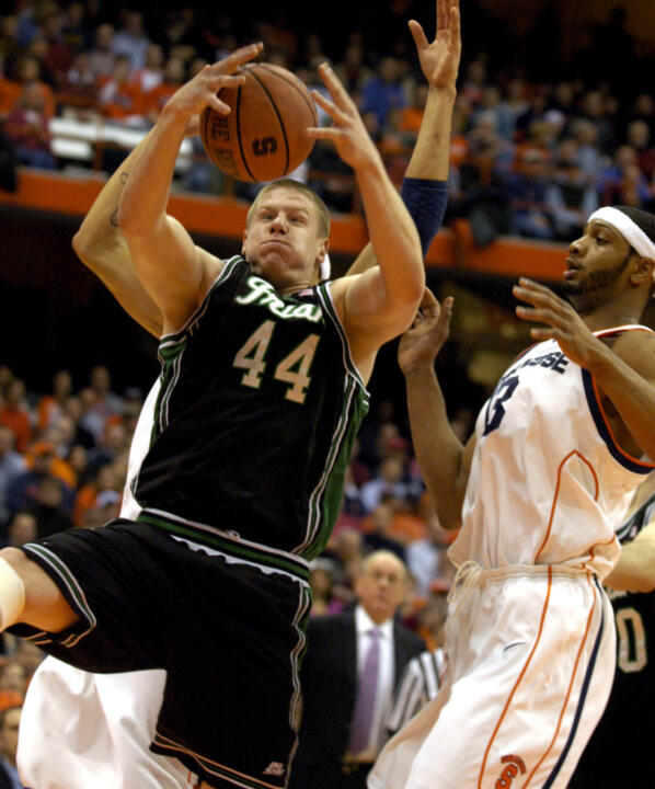 Luke Harangody pulls down a rebound in front of Syracuse's Darryl Watkins, right, during the first half.