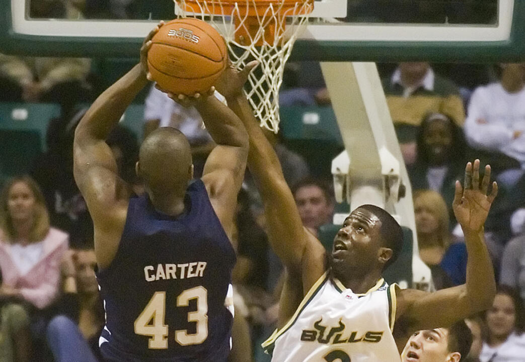 Russell Carter puts up a jump shot over South Florida's Melvin Buckley. (AP Photo/Steve Nesius)