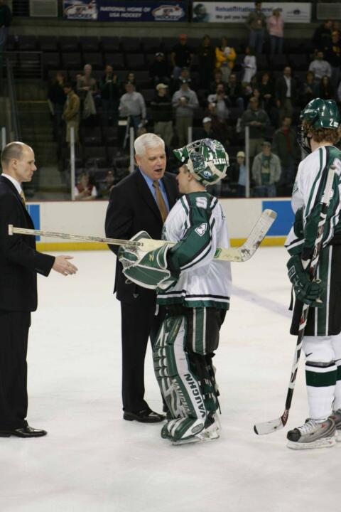 Notre Dame head coach Jeff Jackson and Michigan State goaltender Jeff Lerg in the post-game handshake line following the Irish 3-1 win over the Spartans.