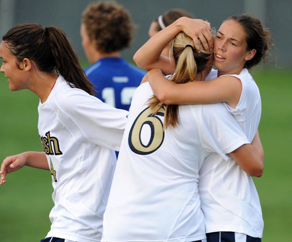 Senior forward Kerri Hanks gives a well-deserved hug to freshman forward Melissa Henderson after the rookie set up the veteran on Notre Dame's first goal in a 3-1 exhibition win over Memphis on Tuesday night at Alumni Field.