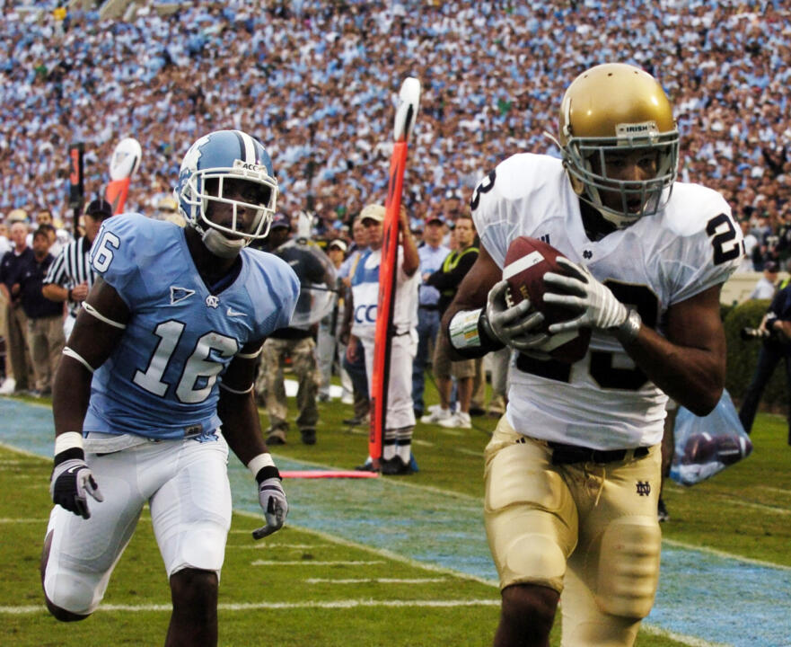 North Carolina's Kendric Burney follows Golden Tate into the end zone for Notre Dame's first touchdown. (AP Photo/Sara D. Davis)