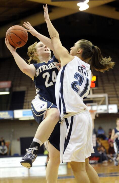Lindsay Schrader drives against Villavona's Tia Grant during the first half.