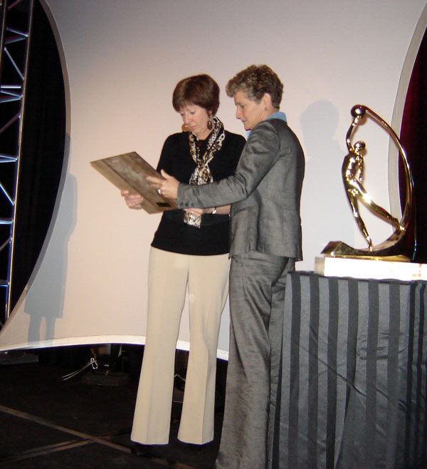 Notre Dame head coach Muffet McGraw is presented with the 2009 WBCA Carol Eckman Award from WBCA CEO Beth Bass during the WBCA Awards Luncheon on Tuesday at the Hyatt Regency Riverfront in St. Louis.