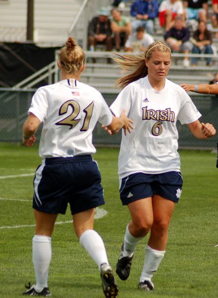 Sophomore forward Melissa Henderson (6) scored twice and junior midfielder Erica Iantorno (21) delivered a pair of assists as third-ranked Notre Dame scored three times in the first 14 minutes before settling for a 3-3 exhibition draw with No. 9 Virginia on Friday in Maple City, Mich.