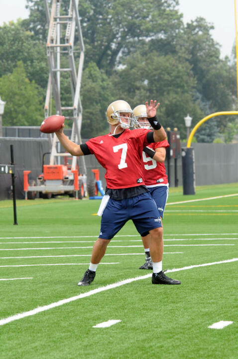 Jimmy Clausen warms up his arm at the beginning of practice on Sunday, August 9, 2009.
