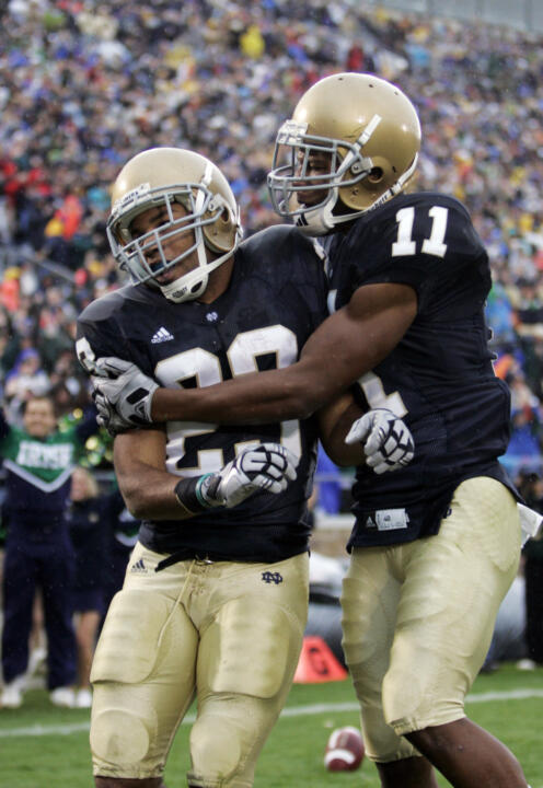 Golden Tate, left, and Shaquelle Evans celebrate Tate's 67-yard touchdown.