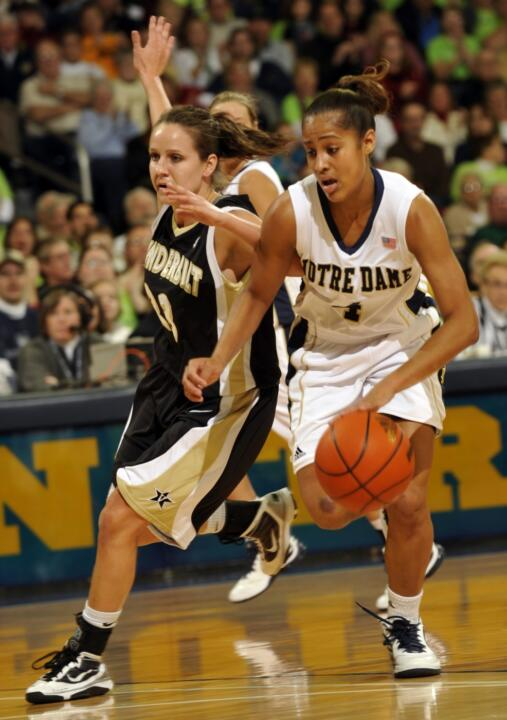 Notre Dame guard Skylar Diggins, right, drives the lane as Vanderbilt guard Meredith Marsh defends during the first half of an NCAA college basketball game on Thursday Dec. 31, 2009, in South Bend, Ind. (AP Photo/Joe Raymond)