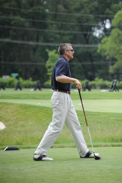 Monogram Club president Joe Restic prepares to tee off at the 2010 Riehle Open.