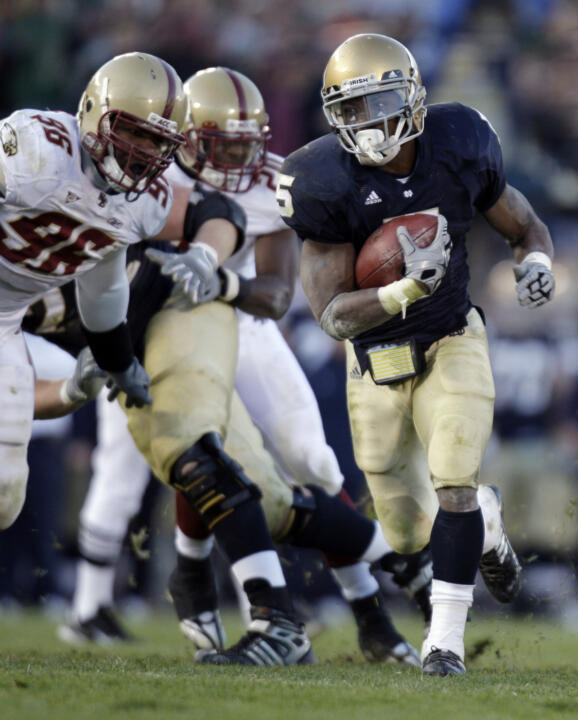 Notre Dame running back Armando Allen Jr., right, gets past Boston College defensive tackle Kaleb Ramsey to pick up a first down in last year's meeting.