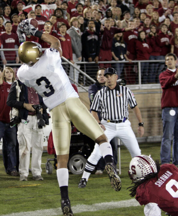 Michael Floyd catches a touchdown pass in front of Stanford's Richard Sherman in last year's meeting with the Cardinal.