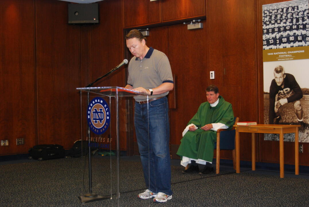 Monogram Club board member Michael Richerson '85 (football) performs a reading at a 2010 post-game Mass.