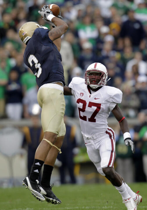 Michael Floyd goes up over Stanford cornerback Johnson Bademosi to make a catch during first half