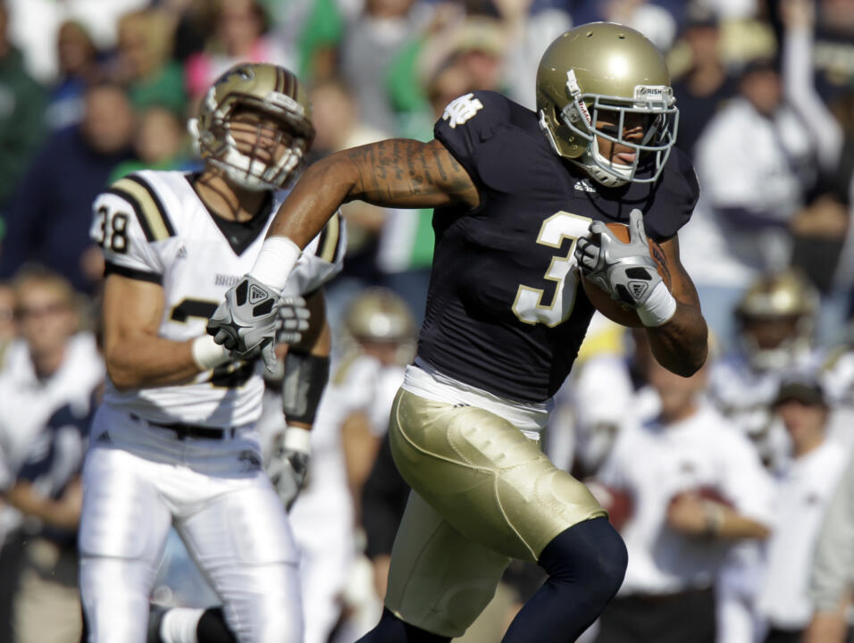 Notre Dame wide receiver Michael Floyd scores on an 80-yard touchdown reception in front of Western Michigan linebacker Chris Prom.