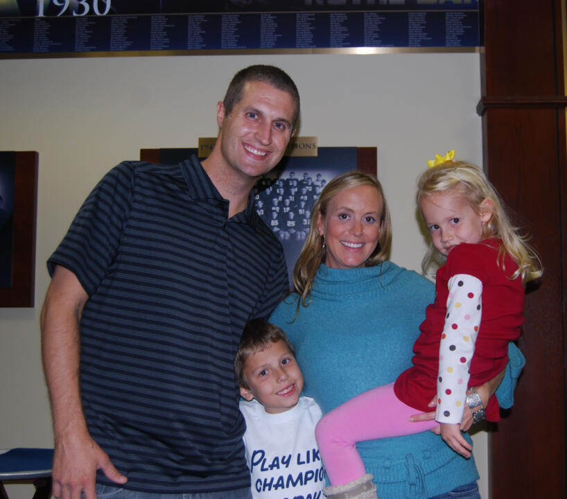 Monogram winner Matt McNew '01 (soccer, football) with his family during the Friday football reception.