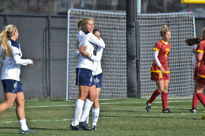 Senior co-captain Lauren Fowlkes (left) celebrates with freshman Elizabeth Tucker after Fowlkes' first-half goal in Notre Dame's 4-0 win over #22 USC in the second round of the NCAA Championship on Sunday afternoon at Alumni Stadium.