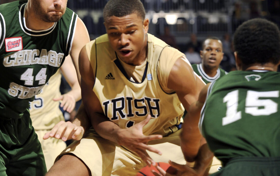 Notre Dame forward Tyrone Nash, middle, works for a rebound between Chicago State center Pawel Kielbasa, left, and guard Jonathan Montgomery