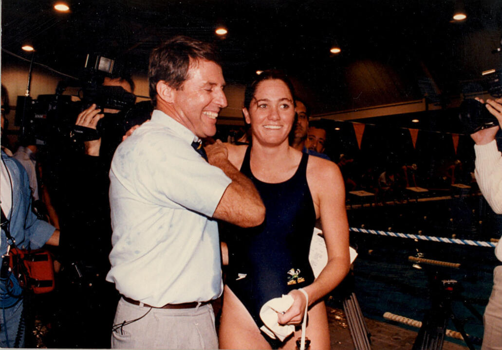 Scott DeMaria celebrates with head coach Tim Welsh (left) after winning her comeback race in 1993.