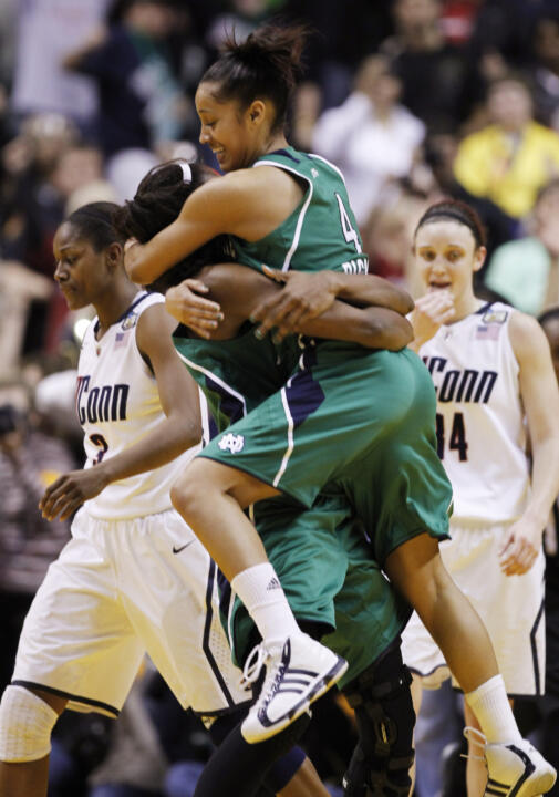 Skylar Diggins jumps into the arms of Devereaux Peters after Notre Dame's 72-63 win over Connecticut in the NCAA Women's Final Four national semifinals on April 3 at Conseco Fieldhouse in Indianapolis.