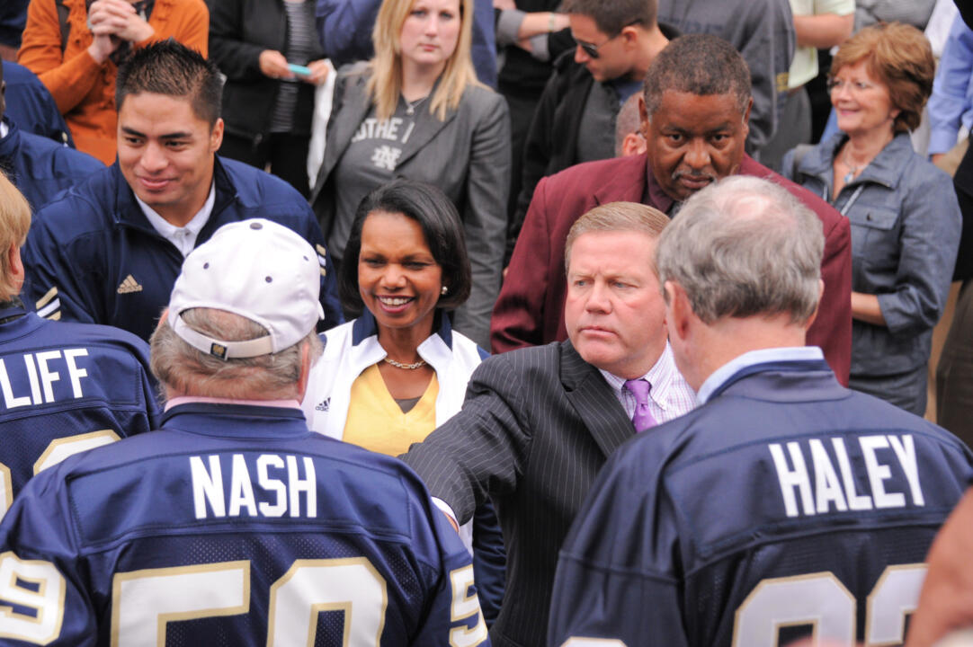 '66 team member Tom Nash is greeted by junior linebacker Manti T'eo and former United States Secretary of State Condoleezza Rice at Friday's pep rally (photo by Mike Bennett)