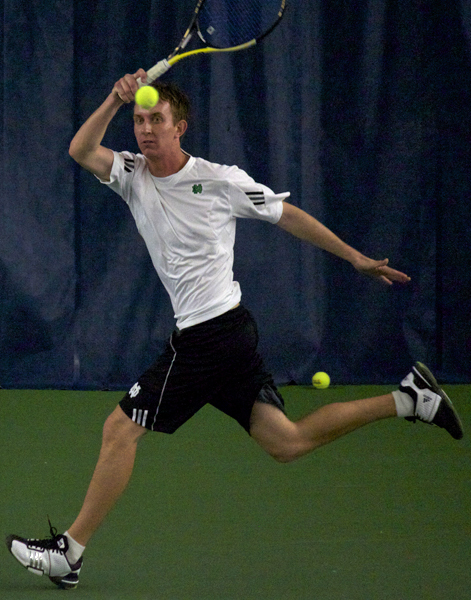 Junior Michael Moore improved to 2-0 at No. 6 singles on Sunday.