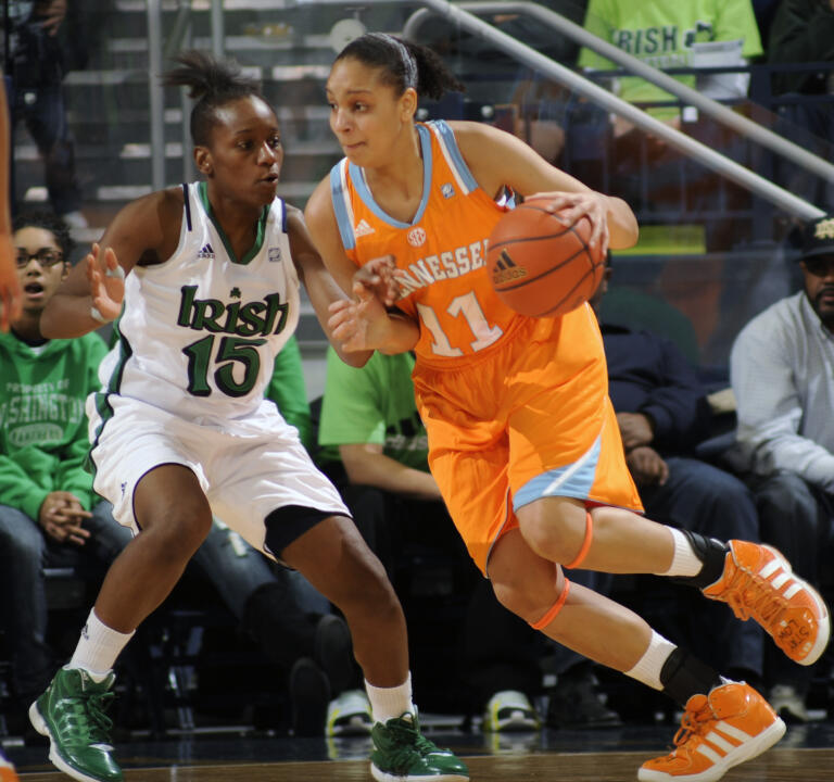 Tennessee guard Cierra Burdick, right, drives the lane as Notre Dame guard Kaila Turner defends.
