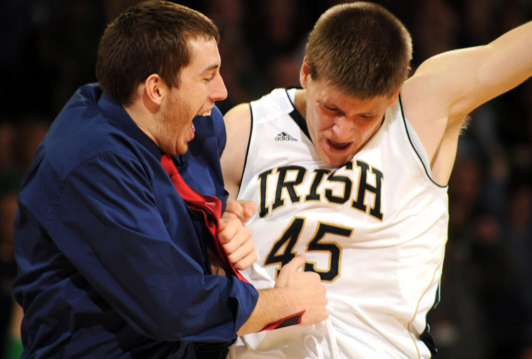 Notre Dame forward Jack Cooley, right, hip bumps with red shirt center Garrick Sherman.
