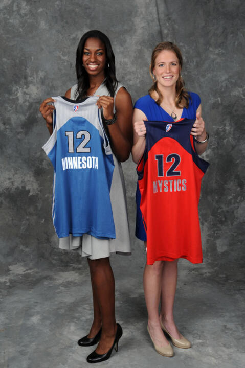 Notre Dame fifth-year senior forward/tri-captain Devereaux Peters (left) and senior guard/tri-captain Natalie Novosel (right) hold up the jerseys of the Minnesota Lynx and Washington Mystics, respectively, after both players were selected among the top eight picks in the 2012 WNBA Draft on Monday afternoon at the ESPN Studios in Bristol, Conn.