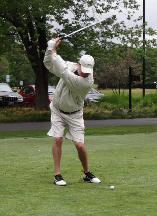 Monogram Club second vice president Kevin O'Connor tees off on the par 3 9th hole at the 2012 Riehle Open.