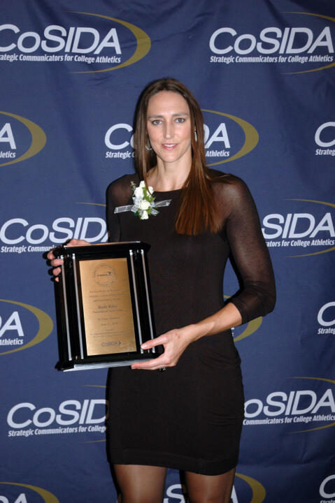 Ruth Riley ('01) holds the plaque signifying her induction into the Capital One Academic All-America Hall of Fame Monday night in St. Louis.