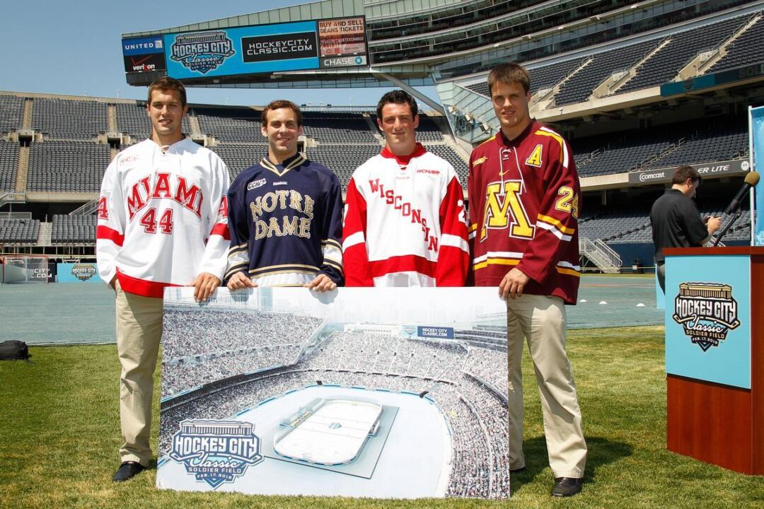 Irish defenseman Sam Calabrese with players from Miami and Wisconsin at Soldier Field.