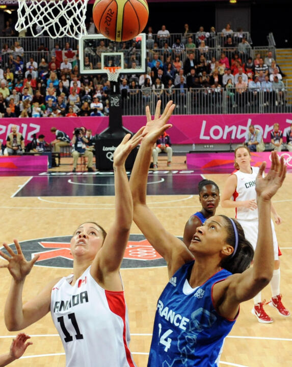 Notre Dame junior forward Natalie Achonwa (left, #11) averaged 7.2 points, 3.8 rebounds and 2.2 assists per game at the 2012 Summer Olympics in London, helping Canada reach the Olympic quarterfinals for the first time since 1984.
